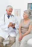 Female senior patient visiting a doctor Royalty Free Stock Images