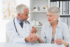 Female senior patient visiting a doctor Stock Photos
