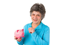 Female senior with piggy bank Stock Photo