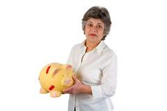 Female senior with piggy bank Stock Photos