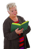 Female senior reading a book Royalty Free Stock Photos
