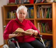 Female senior is reading Stock Photography