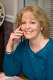 Senior Talks Cellphone Royalty Free Stock Image