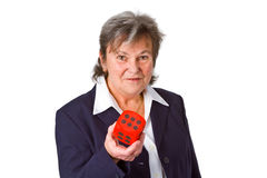 Female senior showing dice Stock Photo