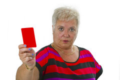 Female senior shows red card Stock Photos