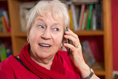 Female senior with smartphone Royalty Free Stock Images