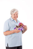 Female senior stand with some gifts, studio shot Stock Images