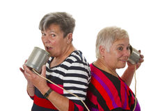 Female Senior Talking With Can Telephone Stock Photography
