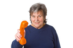 Female senior with telephone receiver Royalty Free Stock Image