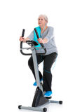 Female senior train with fitness machine Royalty Free Stock Photo