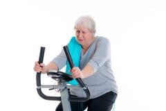 Female senior train with fitness machine Royalty Free Stock Photo
