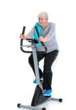 Female senior train with fitness machine Stock Photos