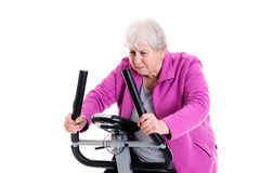 Female senior with train with fitness machine Royalty Free Stock Images