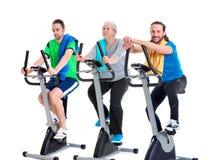 Female senior train with fitness machine and using phone Stock Photo