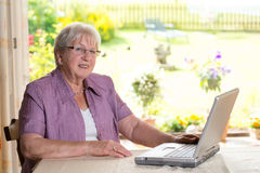 Female senior is using computer Royalty Free Stock Photos