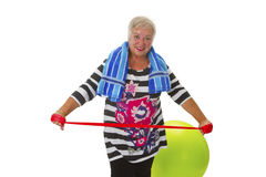 Female senior woman exercises Stock Image