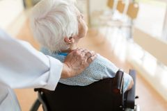 Senior woman in wheelchair with female doctor in hospital royalty free stock images
