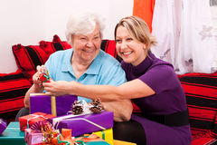 Female senior with young woman and gifts Stock Images