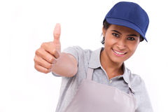 Female service staff giving thumb up gesture Stock Photos