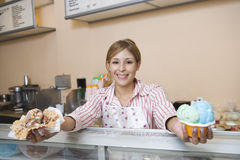 Female Serving Ice Creams Stock Photography