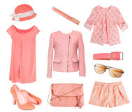 Female set collage salmon coral color isolated. Woman's clothes coral salmon color set.Collage of fashion female clothes & accessories.Summer spring vogue wear stock photography