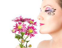 female sexy face with pink chrysanthemum Stock Image