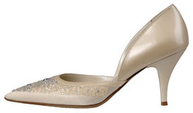 Female shiny beige patent-leather shoe with high heel. On white background royalty free stock photos