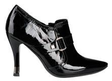 Female shiny black patent-leather shoe with high heel. On white background stock photo