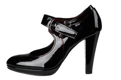 Female shiny black patent-leather shoe with high heel. On white background Royalty Free Stock Photo