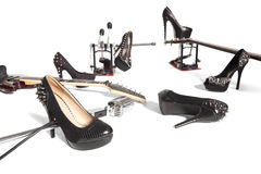 Female shoe and musical instruments scattered Royalty Free Stock Photography