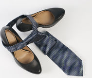 Female shoe and neck tie Royalty Free Stock Images