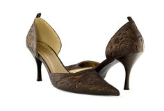Female shoes. Beautiful female shoes on a white background royalty free stock photo