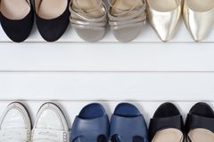 Female shoes background. Female shoes on a white wooden background Royalty Free Stock Image