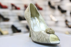 Female shoes. Beautiful female shoes on shop counter stock photography