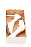Female shoes in box Royalty Free Stock Images