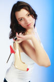 Female shoes high heels in woman hand. Shopping. Royalty Free Stock Photo