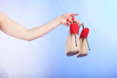 Female shoes high heels in woman hand. Shopping. Royalty Free Stock Images
