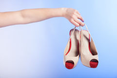 Female shoes high heels in woman hand. Shopping. Royalty Free Stock Photos