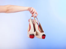 Female shoes high heels in woman hand. Shopping. Stock Image