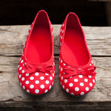 Female shoes made ��of red cloth Royalty Free Stock Photo