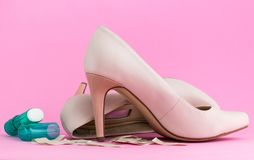 Female shoes, plasters and anti-cellus stick royalty free stock photo