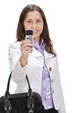 Female shooting with a camera phone. Image of a young woman taking photos using a camera phone Stock Photo