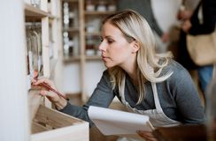 A female shop assistant working in a zero-waste shop. stock photos
