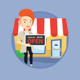 Female shop owner holding open signboard. Royalty Free Stock Photo
