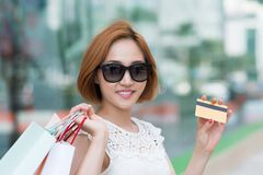 Female shopaholic with credit card Royalty Free Stock Photo