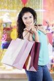 Female shopaholic at shopping center Royalty Free Stock Image