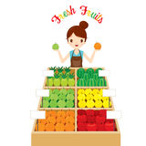 Female Shopkeeper With A Lot Of Fruits In Tray Royalty Free Stock Photos