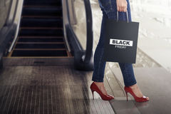 Female shopper with Black Friday paper bag Stock Image