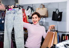 Female shopper boasting her purchases in women's cloths shop Royalty Free Stock Photography