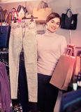 Female shopper boasting her purchases in women's cloths shop Stock Photos